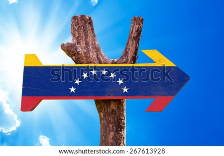 Venezuela Flag wooden sign with sky background - stock photo