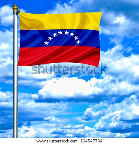 Venezuela waving flag against blue sky - stock photo