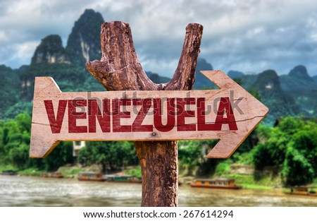 Venezuela wooden sign with countryside background - stock photo