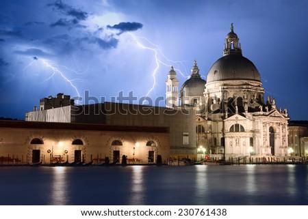 Venice at storm view on Basilica della Salute - stock photo