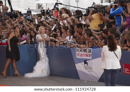 VENICE - AUGUST 31: Maika Monroe and fans for ' At Any Price ' Premiere during the 69th Venice Film Festival on August 31, 2012 in Venice.