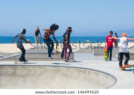 VENICE BEACH, CA - AUG 14:  Skateboarders at Venice Beach in LA on Aug 14, 2012. Venice is one of LA's most popular beaches attracting surfers, skateboards, bohemians, musicians and tourists.  - stock photo