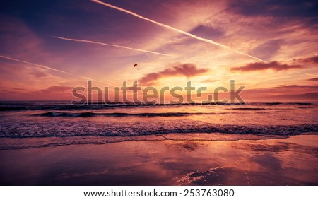 Venice Beach, California. Sunset. Summer, vacation, travel, kitesurfing, parasailing and nature concept. Deep saturated post processing - stock photo