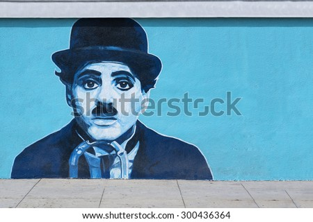 VENICE BEACH CALIFORNIA, USA MAY 29: Charlie Chaplin mural on the wall at Venice Beach in Los Angeles on May 29, 2015. Charlie Chaplin, was an English comic actor and filmmaker, silent film era. - stock photo