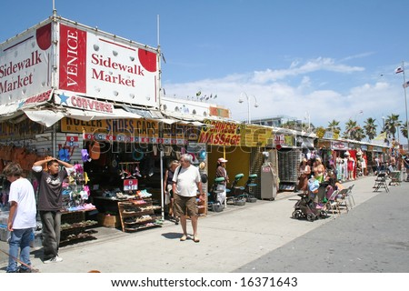 VENICE BEACH, LOS ANGELES, CA - June 16, 2008: Colorful boardwalk shops on the corner of Market street and Ocean Front Walk Venice Beach. - stock photo
