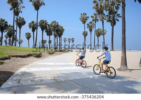 VENICE BEACH, LOS ANGELES, CALIFORNIA - MAY 29, 2015: People enjoying a sunny day on the beach of Venice, California, on May 29, 2015. Summer time activities. - stock photo