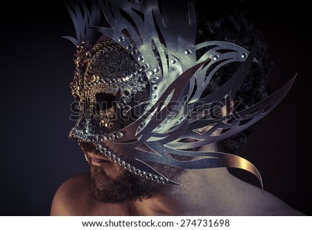 Venice, bearded man with silver mask Venetian style. Mystery and renaissance - stock photo