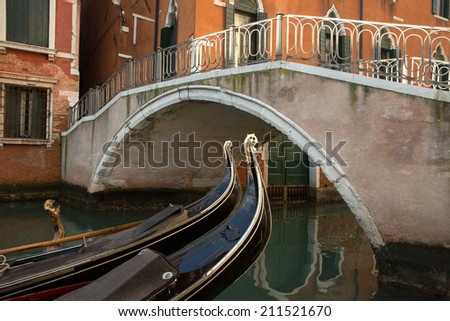 Venice building and typical bridge over water channel with gondola boat details, Italy - stock photo