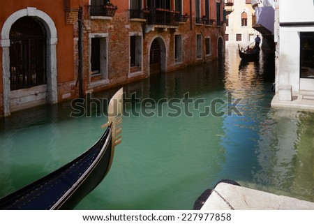 Venice buildings over water channel with gondola boat details, Italy - stock photo