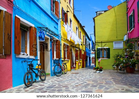 Venice, Burano island street with small colored houses and bicycles,  Italy - stock photo