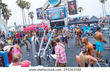 VENICE, CA JULY 4th, 2015: Bodybuilders warming up and posing at the Muscle Beach Championship bodybuilding contest on July 4th, 2015 at Venice Beach, CA.