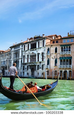 Venice canal with gondola in summer bright day, Italy - stock photo