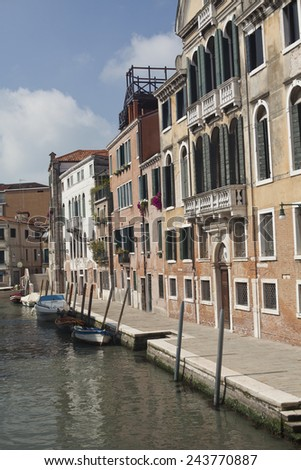 Venice cityscape, boats, water canal, bridge and old traditional buildings. Italy, Europe