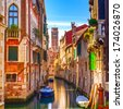 Venice cityscape, narrow water canal, campanile church on background and traditional buildings. Italy, Europe. - stock photo