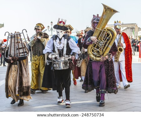 VENICE-FEB 2011: Funny orchestra marching and singing in the streets during the Carnival days on 26 February 2011 in Venice.In 2015 the Venice Carnival is between January 31-February 17 - stock photo