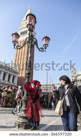 VENICE-FEB 18:Tilted image of a person wearing a complex disguise posing on February 18, 2012 in Venice. Venice Carnival is one of the biggest carnival in the world. - stock photo