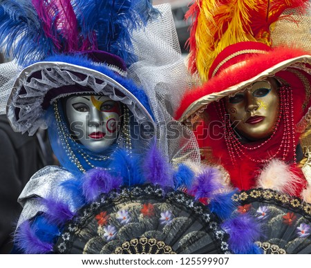 VENICE-FEB 19: Unidentified persons wearing complex and interesting Venetian disguises on February 19, 2012 in Venice. In 2012 the Venice Carnival was held between 11- 21 February.