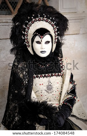 VENICE - FEBRUARY 28: An unidentified person in costume in St. Mark's Square during the Carnival of Venice on February 28, 2011. The annual carnival was held in 2011 from February 26th to March 8th. - stock photo
