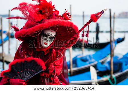 VENICE, FEBRUARY 10: An unidentified woman in typical dress poses during Venice Carnival on February 10, 2013 in Venice - stock photo