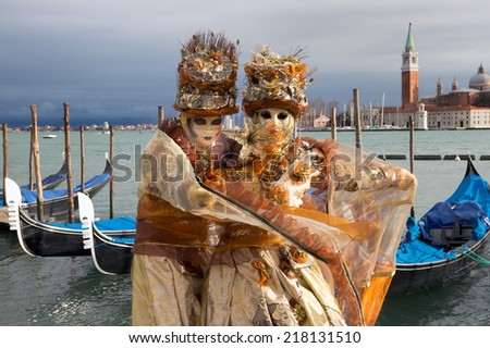 VENICE - FEBRUARY 6: Costumed people on the Piazza San Marco during Venice Carnival on February 6, 2013 in Venice, Italy. This year the Carnival was held between January 26 - February 12.  - stock photo
