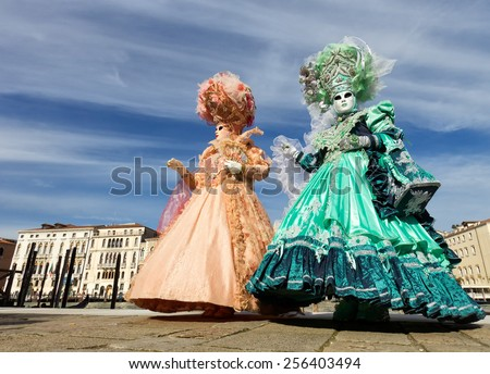 VENICE - FEBRUARY 7: Costumed people on the Piazza San Marco during Venice Carnival on February 7, 2013 in Venice, Italy. This year the Carnival was held between January 26 - February 12. - stock photo