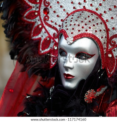 VENICE - FEBRUARY 17: Person in Venetian costume attends the Carnival of Venice, festival starting two weeks before Ash Wednesday on February 17, 2011 in Venice, Italy. - stock photo
