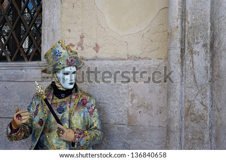 VENICE - FEBRUARY 8: Person in Venetian costume attends the Carnival of Venice, festival starting two weeks before Ash Wednesday on February 8, 2013 in Venice, Italy.