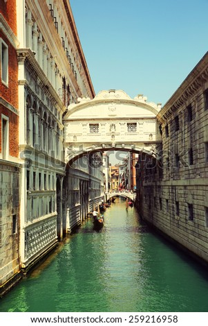 Venice. Gondolas passing over Bridge of Sighs - stock photo
