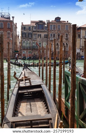 Venice gondolier in grand canal. Italy.