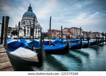 Venice, Grand Canal, famous church of Santa Maria della Salute at sunset - stock photo