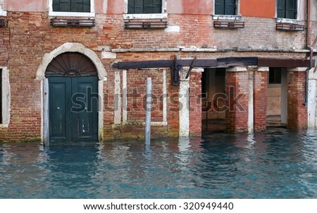 Venice house in Canal Grande during high tide