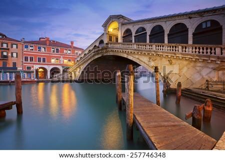 Venice. Image of Rialto Bridge in Venice at dawn. - stock photo