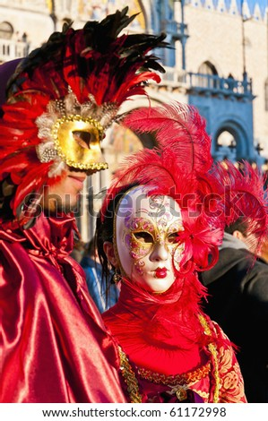 VENICE, IT - FEBRUARY 14: Unidentified disguised couple posing at the Carnival of Venice February 14, 2009 in Venice, IT. - stock photo