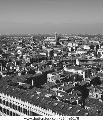 Venice (Italy). A view from above. Doge's palace arches and roof at foreground. Aged photo. Black and white. - stock photo
