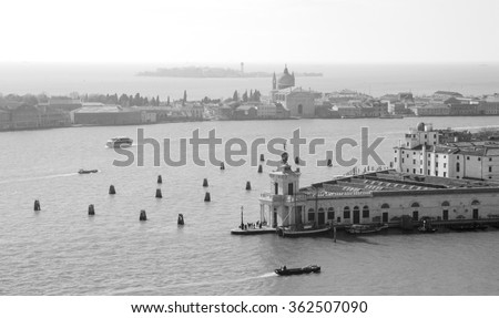 Venice (Italy). A view from St Mark's Campanile. Giudecca island is seen at backgrounds. Aged photo. Black and white. - stock photo