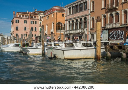 Venice Italy 27 April 2014 Boats and watercraft traverse along  the Canals and Waterways of famous Venice