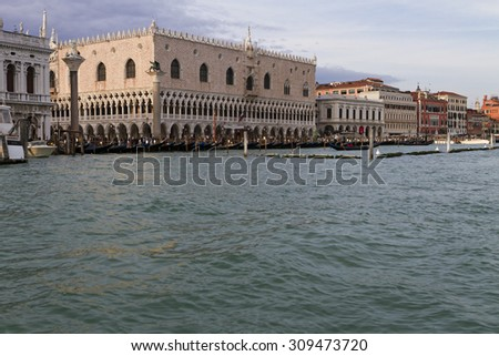 Venice, Italy - April 1, 2013: Street views of canals and ancient architecture in Venice, Italy.