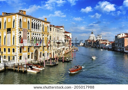 VENICE, ITALY - APRIL 12: View of the Grand Canal from Ponte dell Accademia on April 12, 2013 in Venice, Italy. This main canal is 3800 meter long, 30-90 meters wide, with an average depth of 5 meters