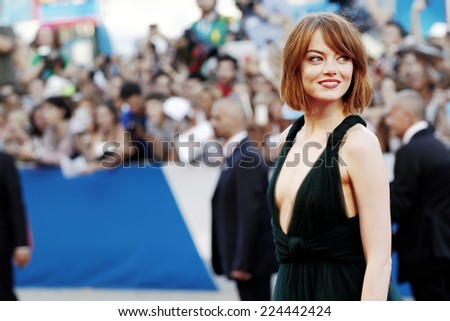 VENICE, ITALY - AUGUST 27: Actress Emma Stone attends the 'Birdman' premiere during the 71st Venice Film Festival at Palazzo Del Cinema on August 27, 2014 in Venice, Italy.  - stock photo