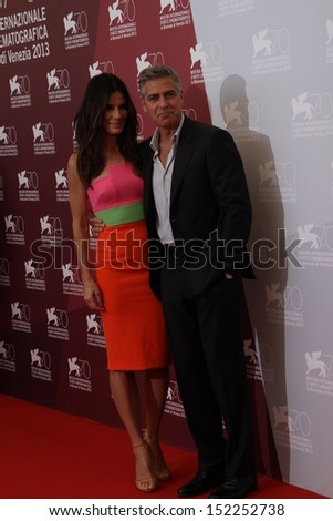 VENICE, ITALY - AUGUST 28: Actress Sandra Bullock and actor George Clooney attend 'Gravity' Photocall during the 70th Venice Film Festival at the Casino on August 28, 2013 in Venice, Italy. - stock photo