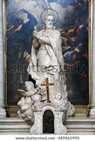 Venice, Italy - August 09, 2016:Altar of Santa Maria della Salute church with Giovanni Morlaiter statue. Morlaiter was one of the ablest sculptors in eighteenth century Venice.