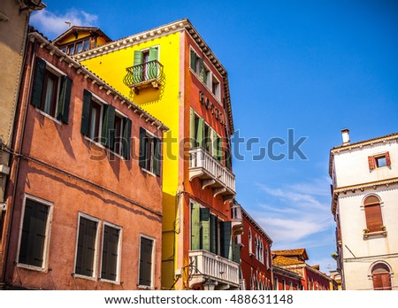 VENICE, ITALY - AUGUST 17, 2016: Famous architectural monuments and colorful facades of old medieval buildings close-up on August 17, 2016 in Venice, Italy.