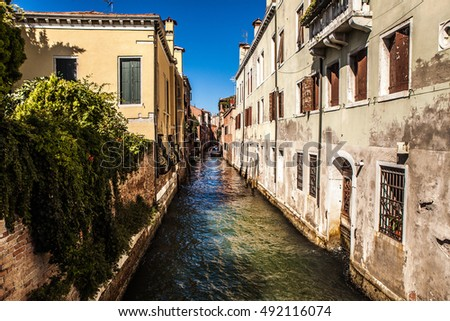 VENICE, ITALY - AUGUST 20, 2016: Famous architectural monuments and colorful facades of old medieval buildings close-up on August 20, 2016 in Venice, Italy.