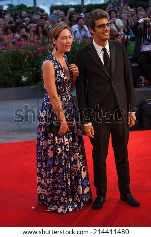 VENICE, ITALY - AUGUST 31: (L-R) Cristiana Capotondi and Pierfrancesco Diliberto attend the 'Hungry Hearts' premiere during the 71st Venice Film Festival on August 31, 2014 in Venice, Italy