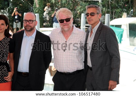 VENICE, ITALY - AUGUST 31: Paul Giamatti,  Philip Seymour and George Clooney arrive to the Casin�² during the 68th Venice Film Festival on August 31, 2011 in Venice, Italy. - stock photo