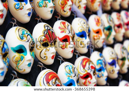 VENICE, ITALY - AUGUST 24, 2014: Side view of authentic and original Venetian full-face masks for Carnival in street shop of Venice, Italy. Handmade masks with ornate design and bright colors. - stock photo