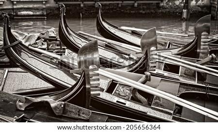 Venice Italy, black and white gondolas - stock photo