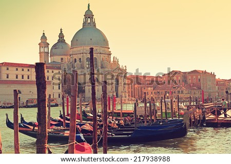 Venice Italy Canal Grande Gondola and Salute. Cathedral church Santa Maria?? della Salute. - stock photo