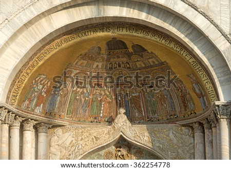 VENICE, ITALY-DECEMBER 18, 2015: mosaics decoration above the entrance door of the San Marco's cathedral facade, in the famous San Marco's square, in Venice.