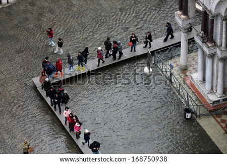 VENICE, ITALY - DECEMBER 26: Venice flooded from the high water of the 2013 season in December 26, 2013 in Venice, Italy  - stock photo